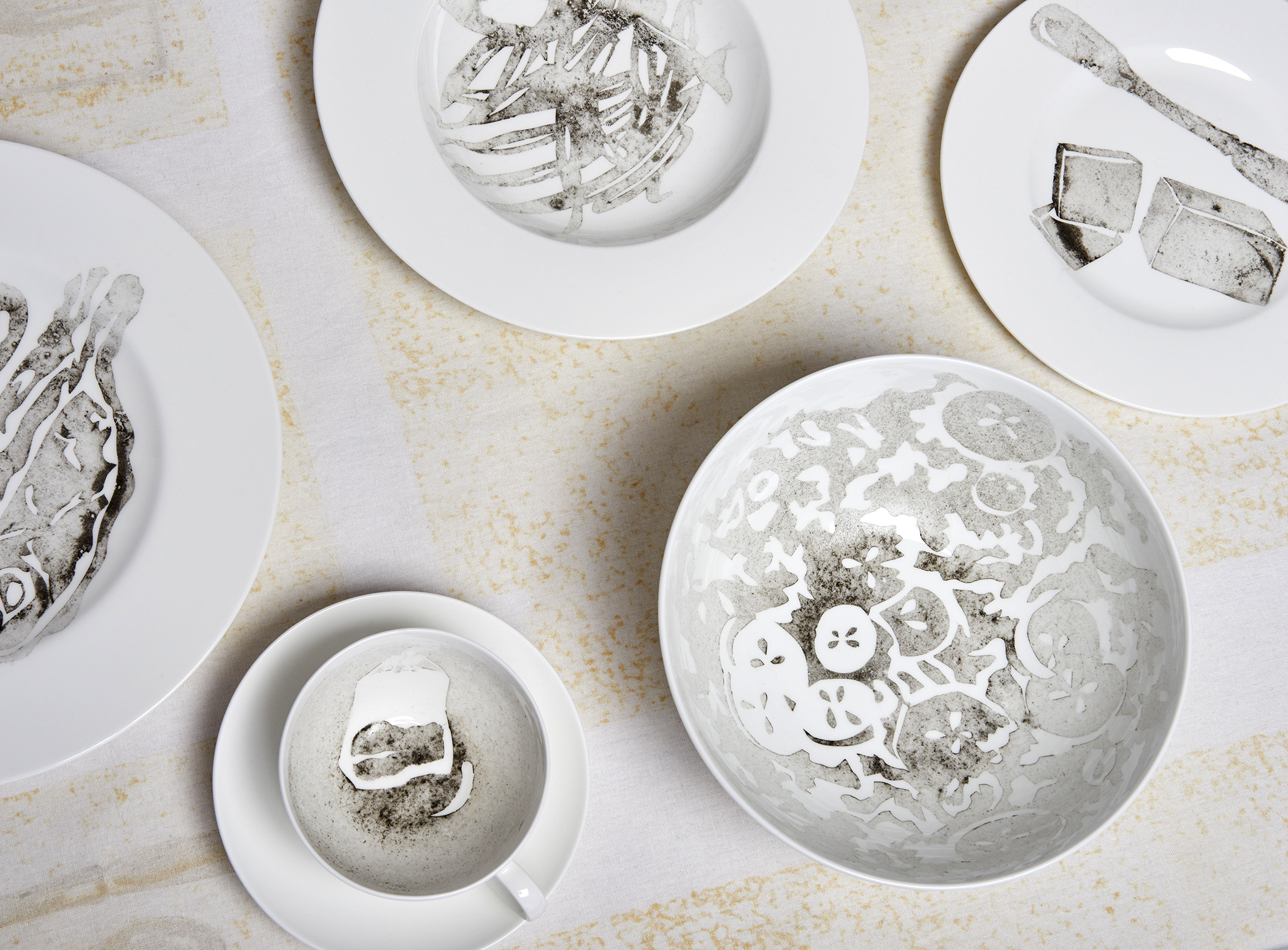 "Detail of ""Dinner for Two in One Month of Smog"" (2011) Smog (particulate matter) on porcelain dinnerware and linen"